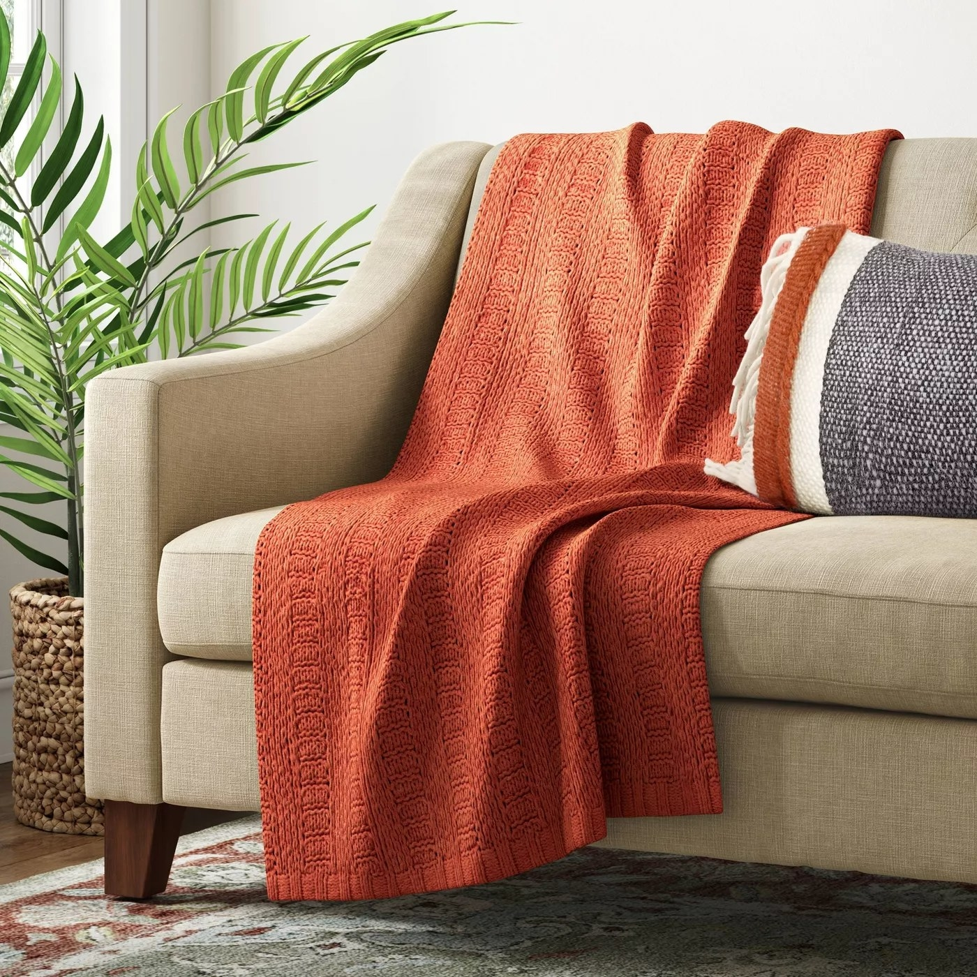 The blanket draped over a couch
