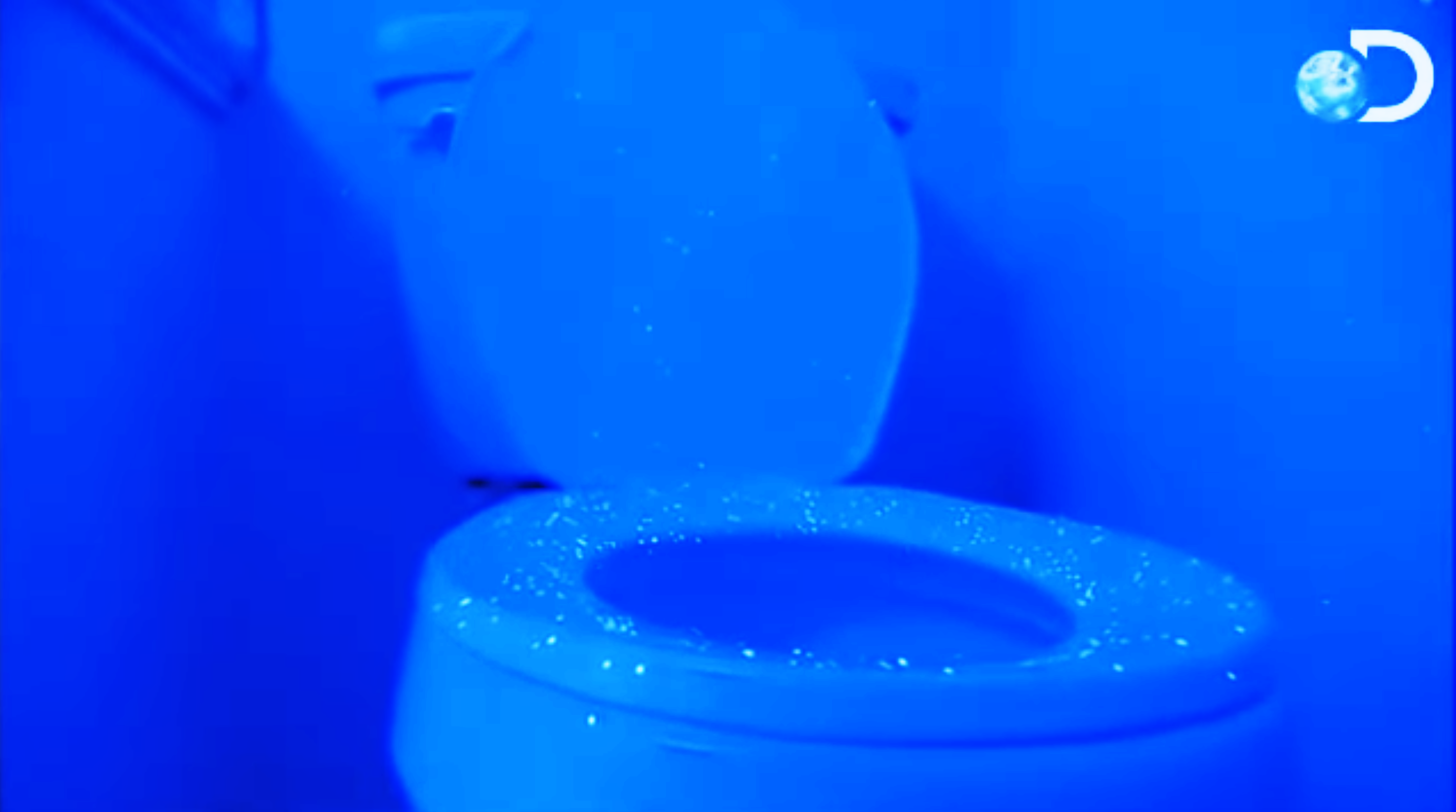 The blacklight shows spatter all over the toilet seat