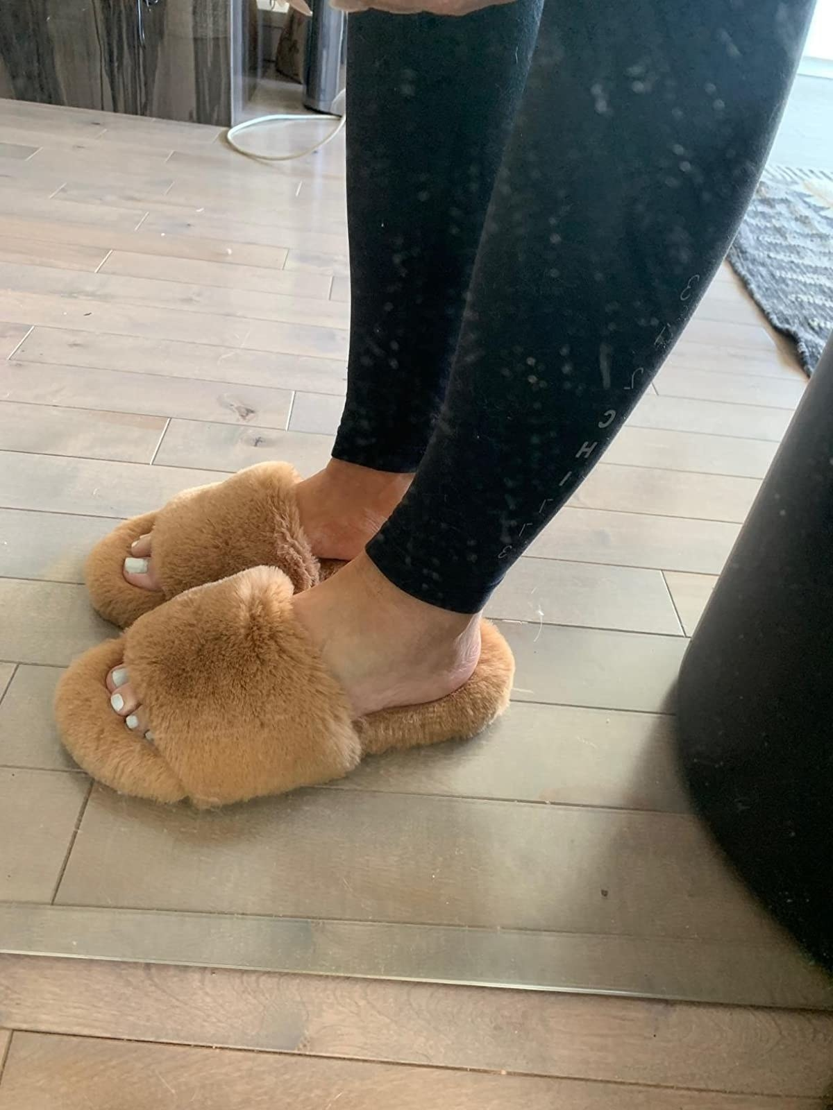 Reviewer's photo of their tan slippers