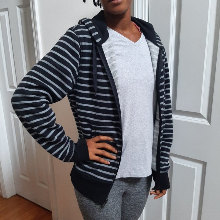 reviewer in black and white stripe hoodie
