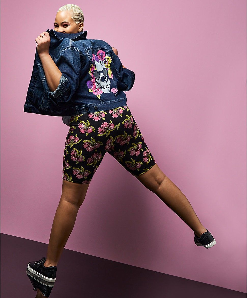 model wearing the black shorts with pink cherry design