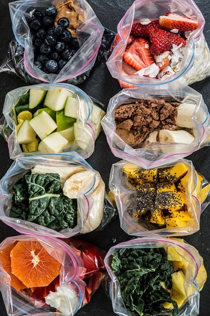 Frozen smoothie packs containing fruits and veggies.