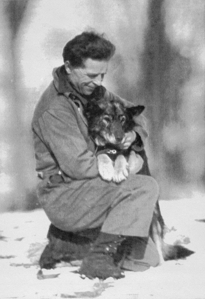 A man holding a husky in his arms