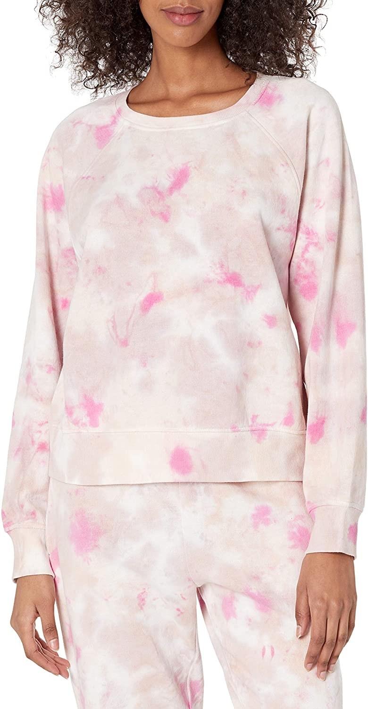 Model wears pink tie dye sweatshirt and matching joggers