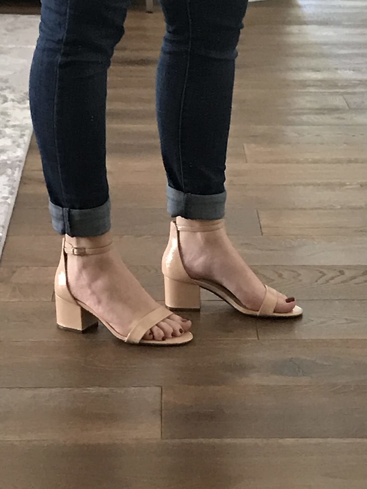 reviewer wearing tan sandals with dark wash jeans