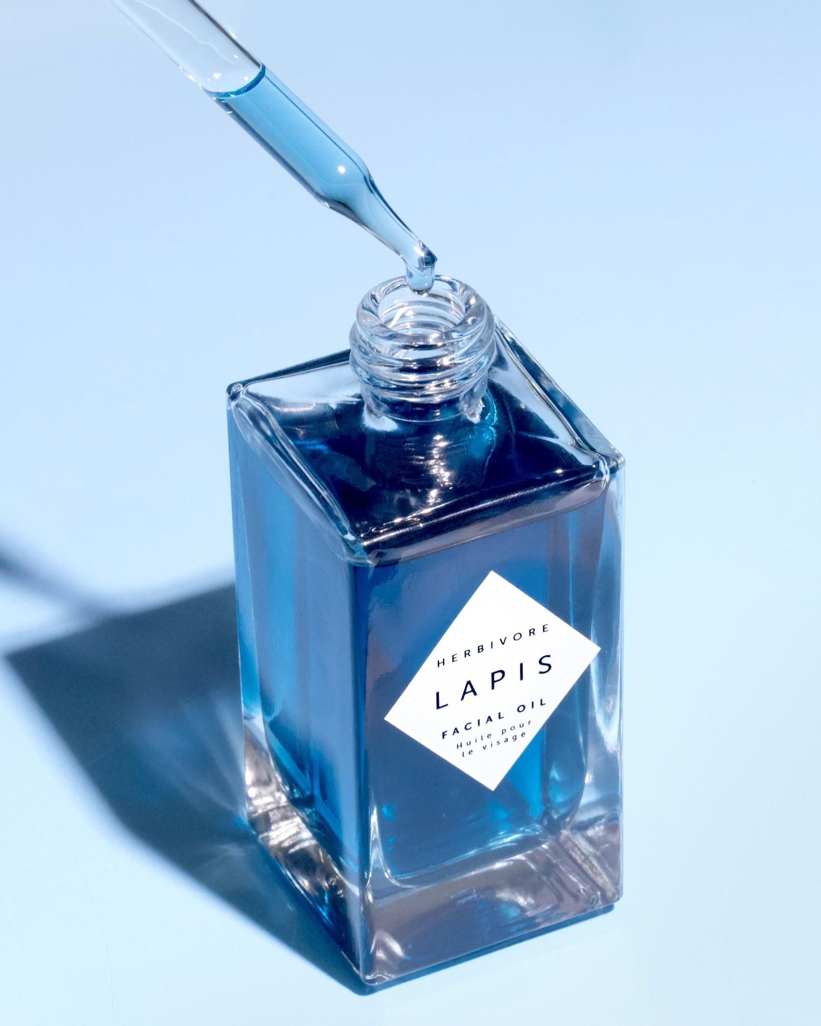 The dropper bottle of blue oil