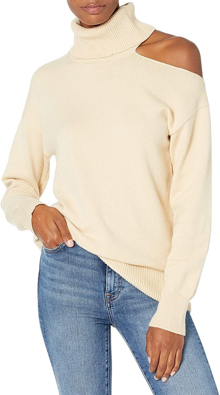 Model wears cream cutout sweater