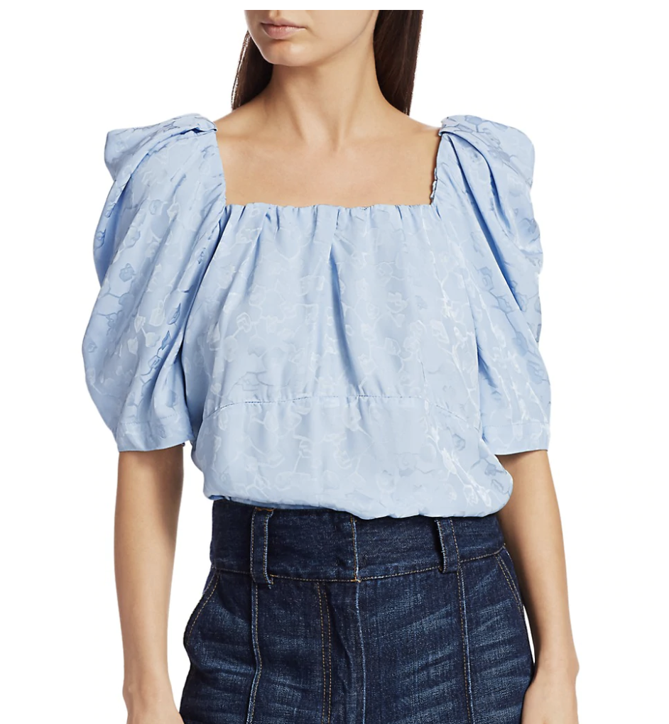 model wears blue puffy sleeve top