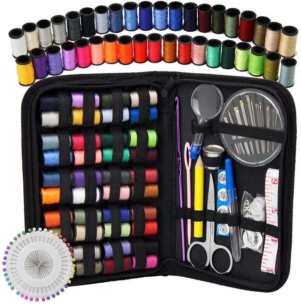 A small fabric case filled with sewing equipment like thread, scissors, needles, and a stitch ripper
