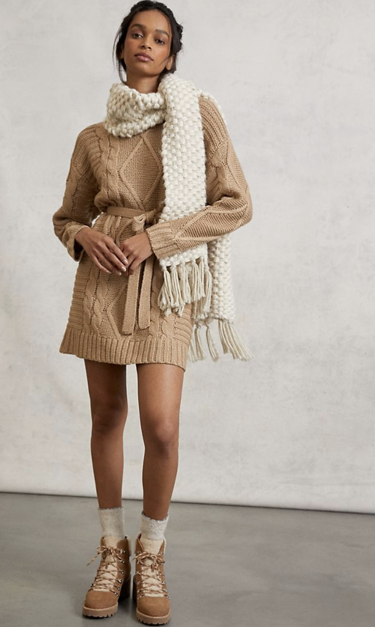 model wears knit sweater dress in cedar