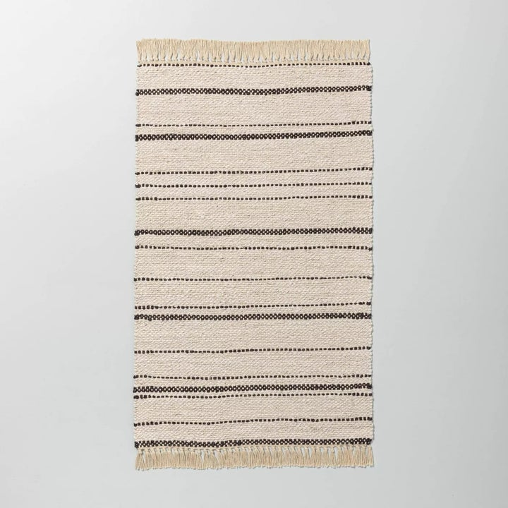 A close-up of the rug against a gray background