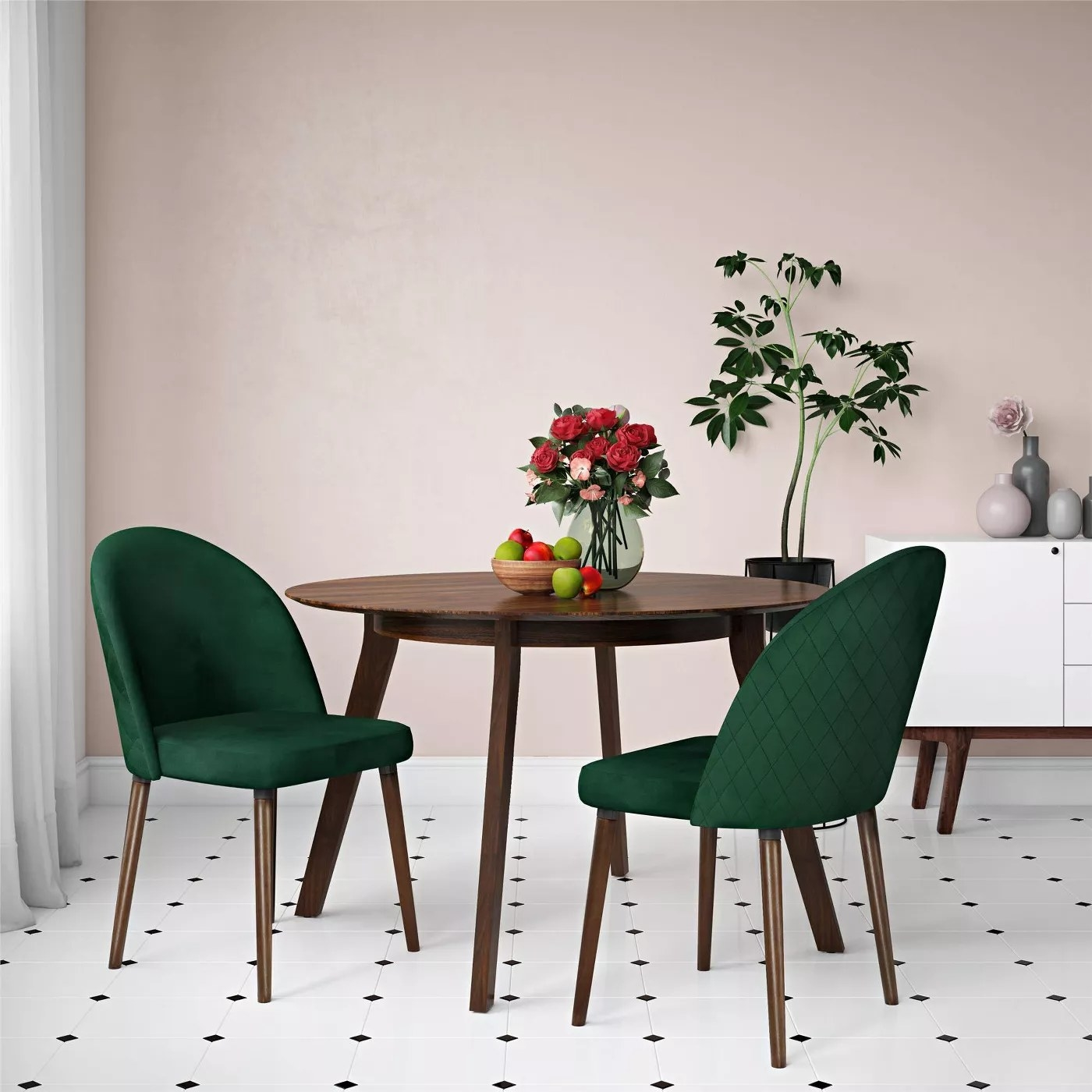 The two chairs in green placed by a dining table