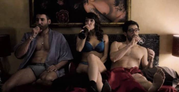 "The shirtless characters from Netflix's ""Sense8"" sitting on a bed together"