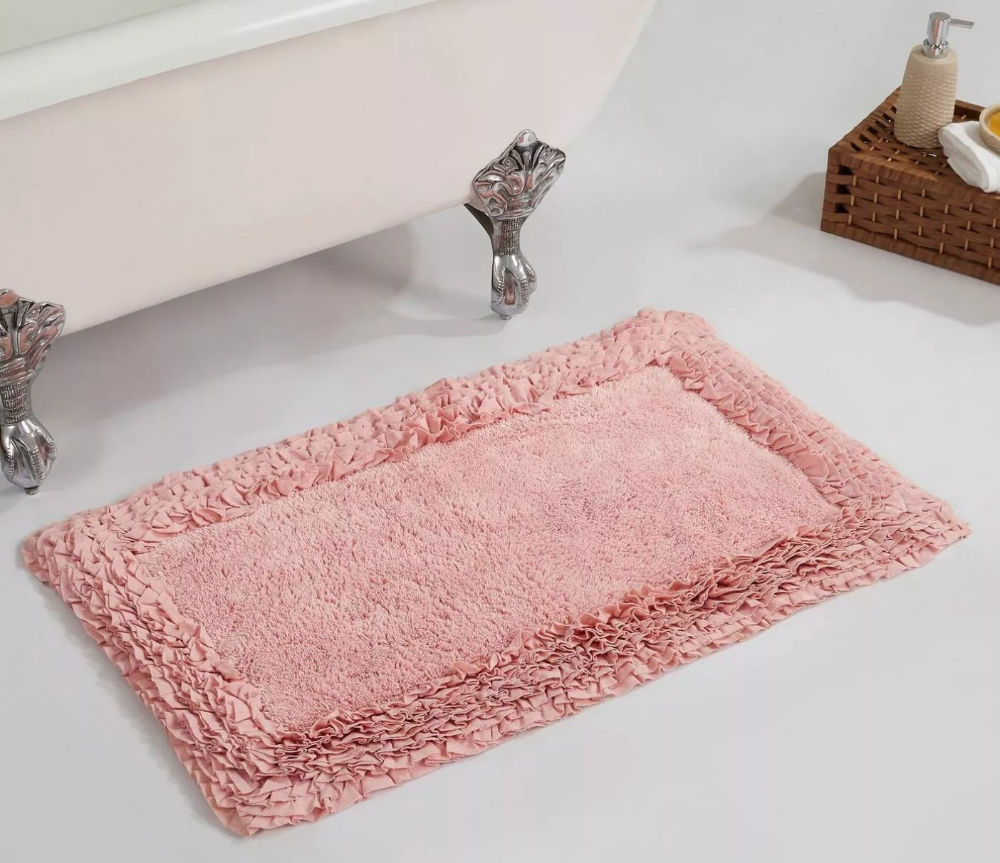 The shaggy border collection bath rug in pink