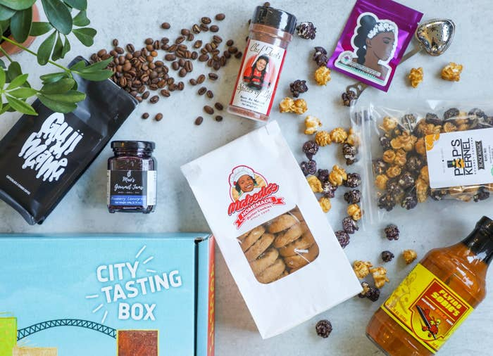 the box with a variety of food items like coffee, cookies, popcorn, and hot sauce