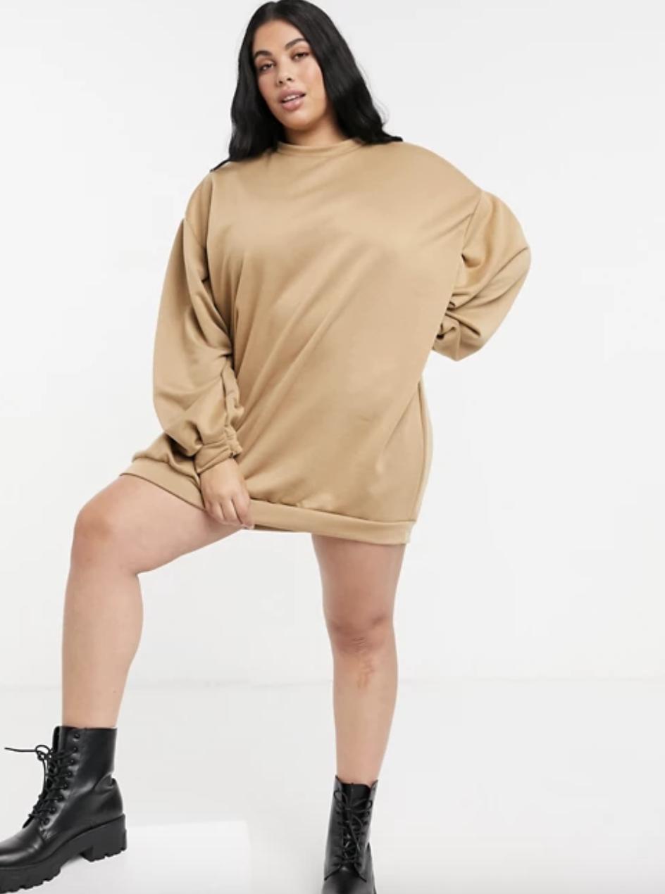 model wearing tan sweater dress