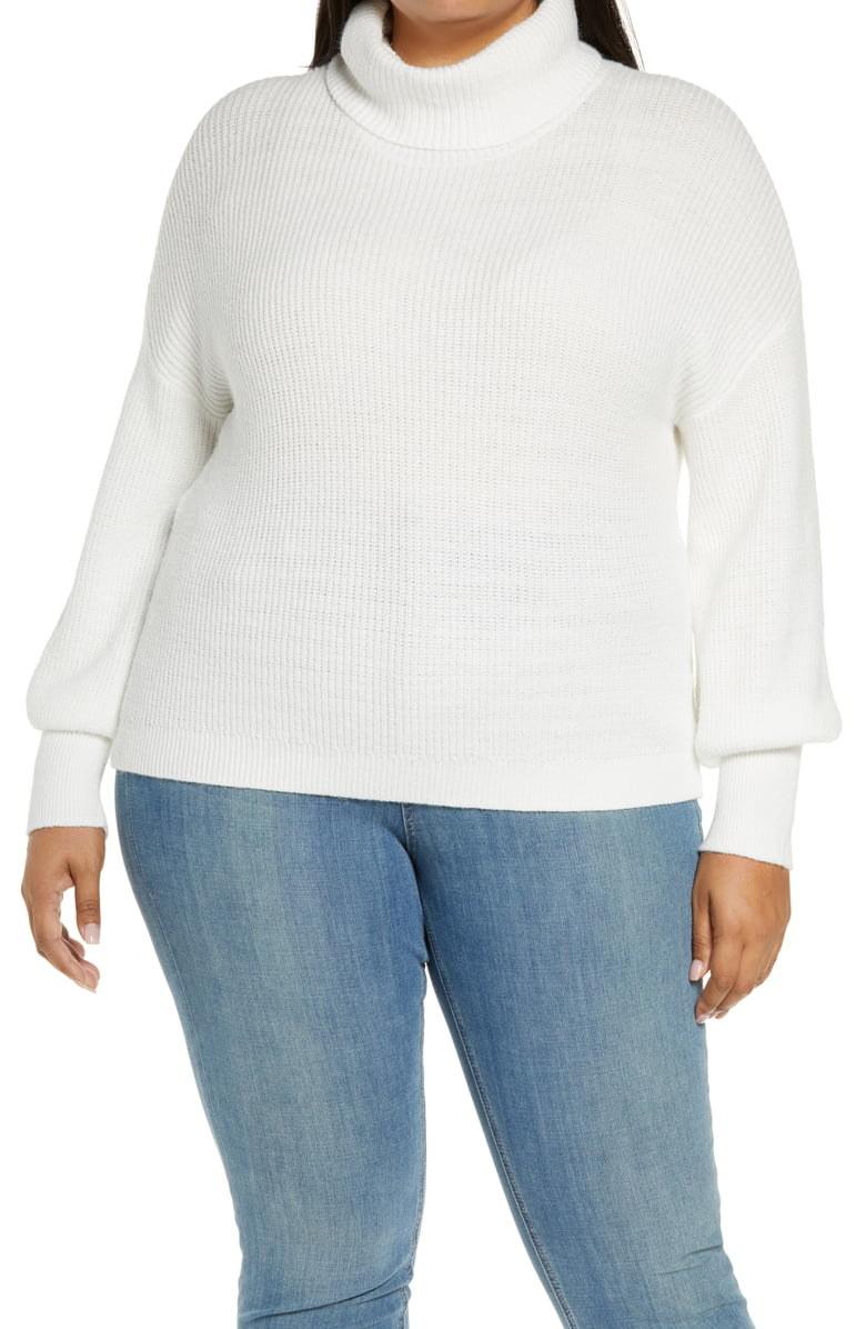 model wearing white turtleneck sweater