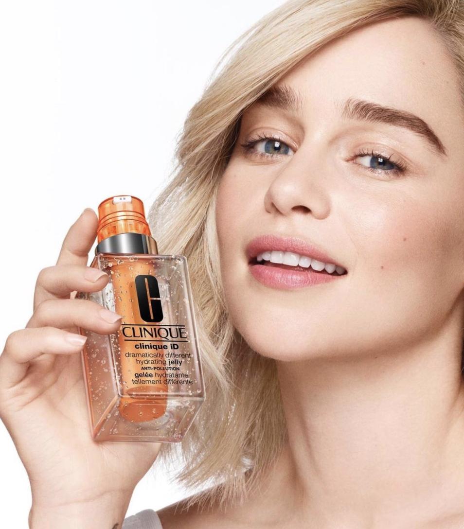 Emilia Clarke holding her custom CliniqueID mixture