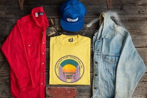 a vintage jean jacket, button down shirt, T-shirt, and navy blue hat from Comma Vintage