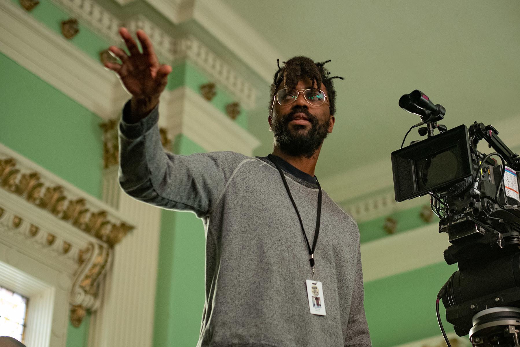 Director Shaka King directing a camera