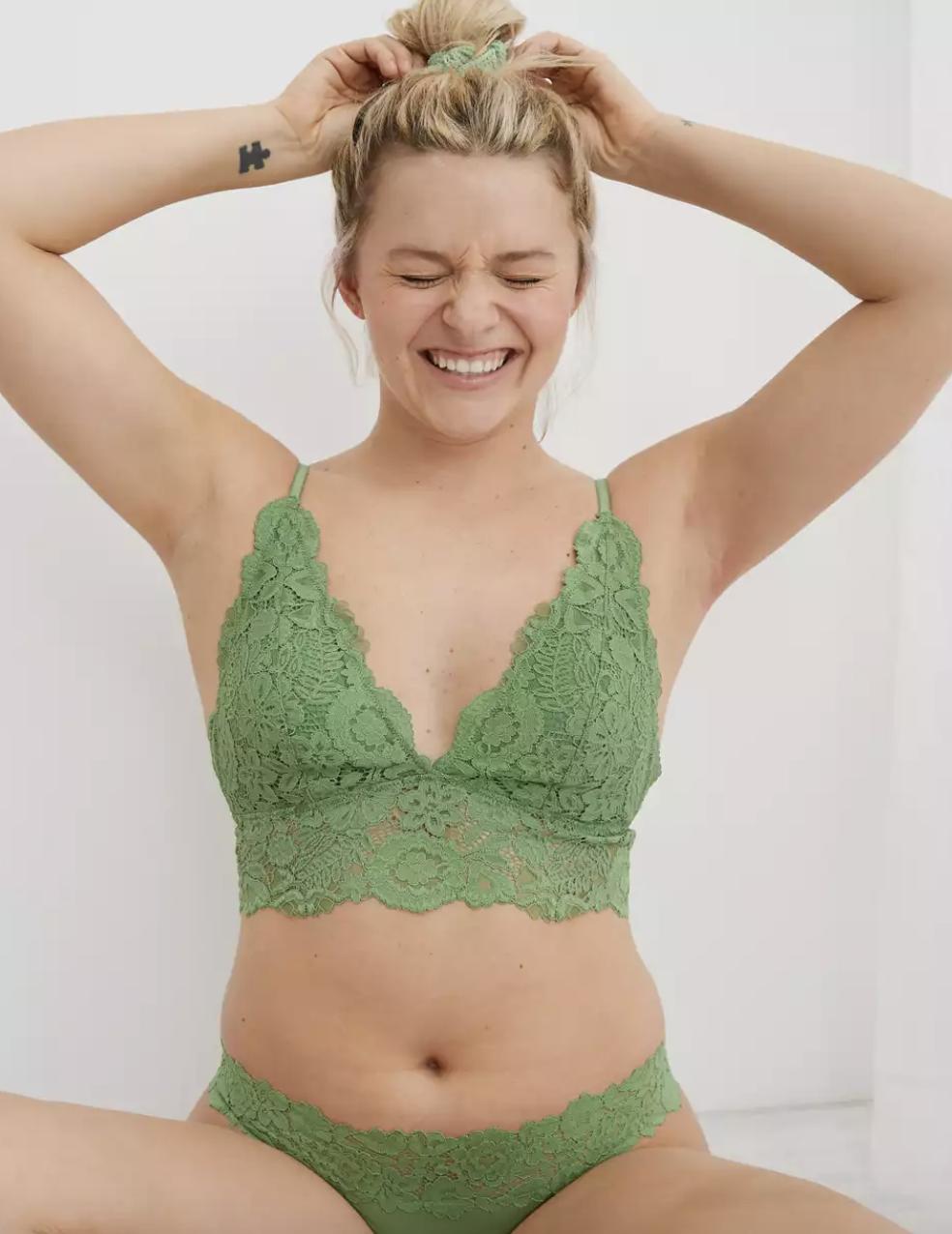 model wearing green lace bralette
