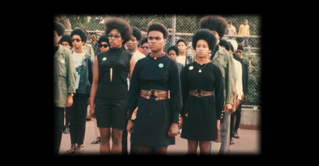 Archival footage of members of the Black Panther party standing outside