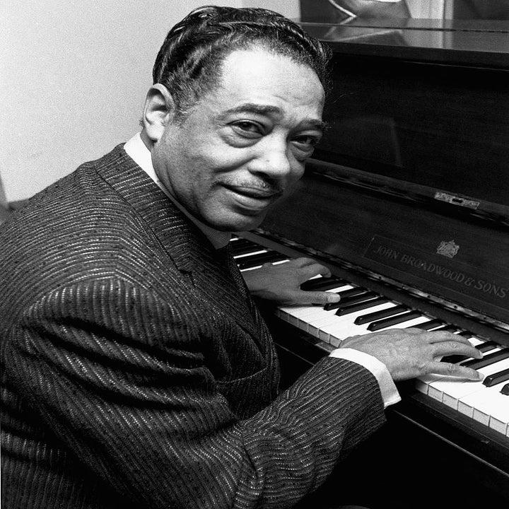Duke Ellington sitting at the piano