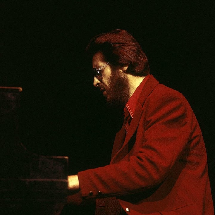 Bill evans performing on the stage at the piano