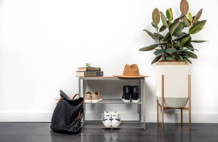 The three-tier rack holding shoes
