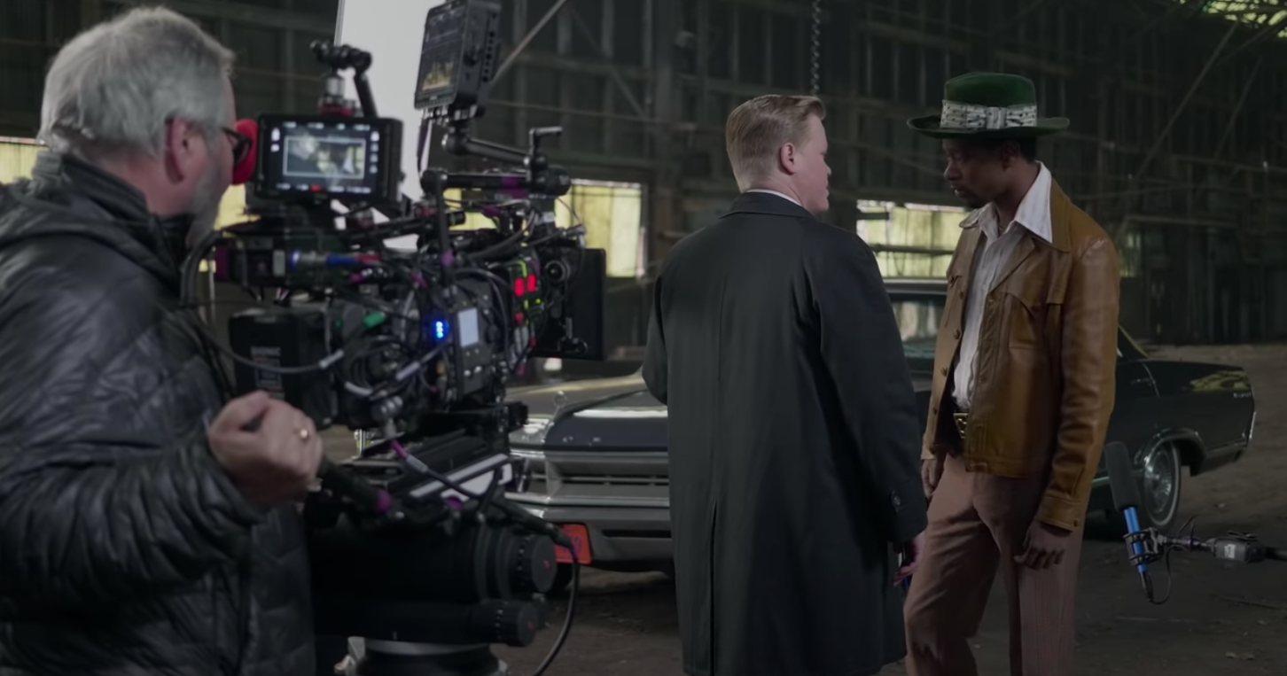 Behind-the-scenes image of LaKeith Stanfield and Jesse Plemons acting in a scene together
