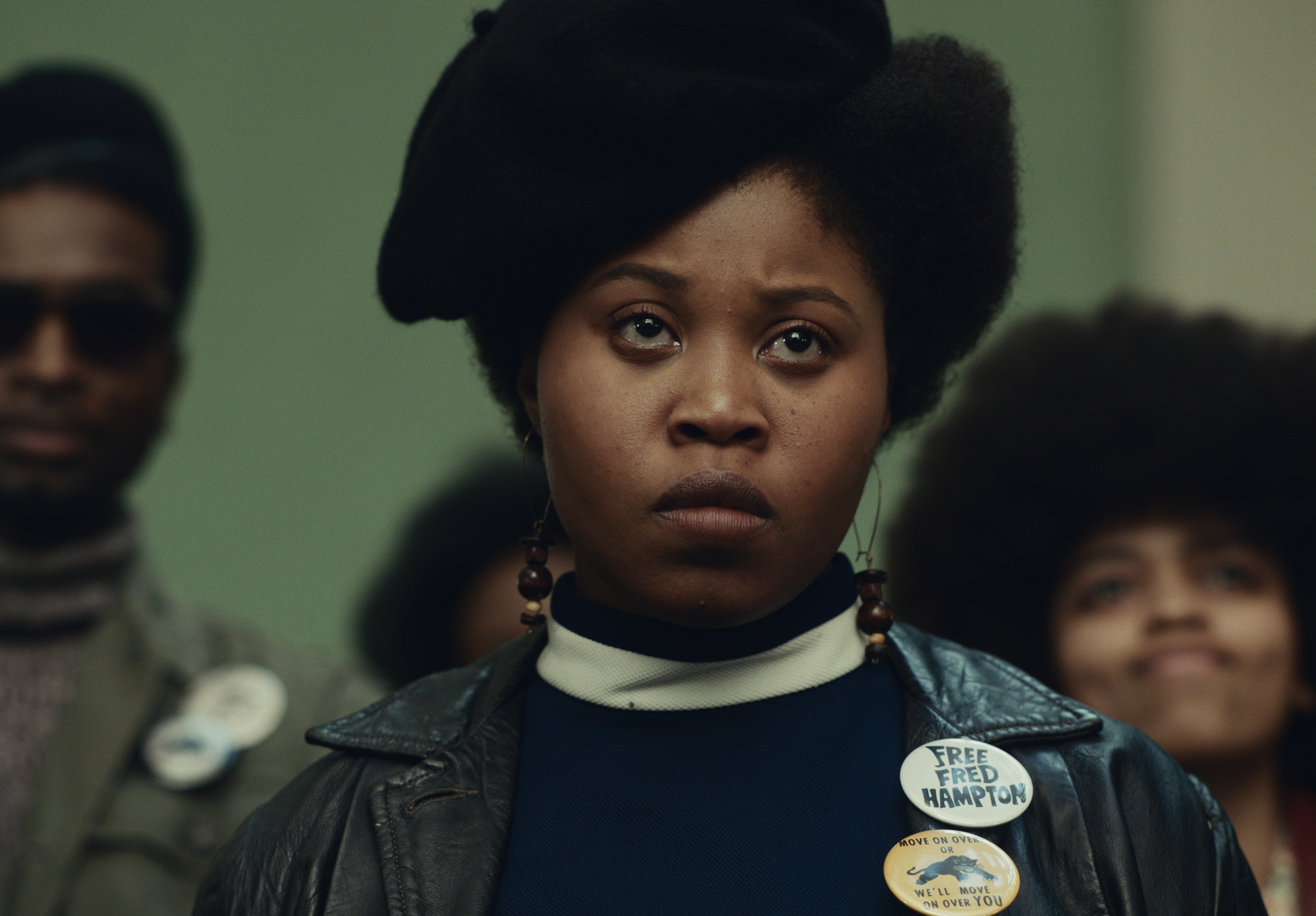 Dominique Fishback in character as Deborah Johnson in the film, wearing a black beret and leather vest