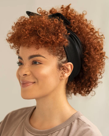model with curly hair wearing the bandie in black