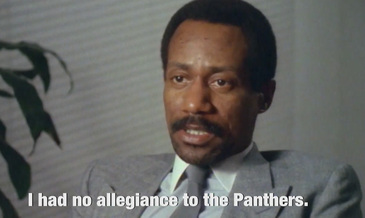 "Still frame of the real William O'Neal in a documentary saying, ""I had no allegiance to the Panthers"""