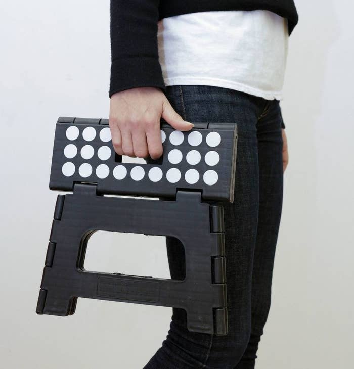 Person holding step stool
