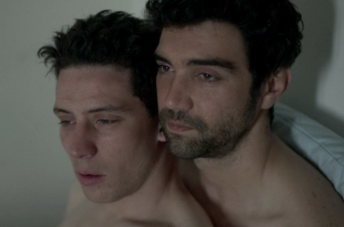 "Two men lying next to each other in bed in Netflix's ""God's Own Country"""