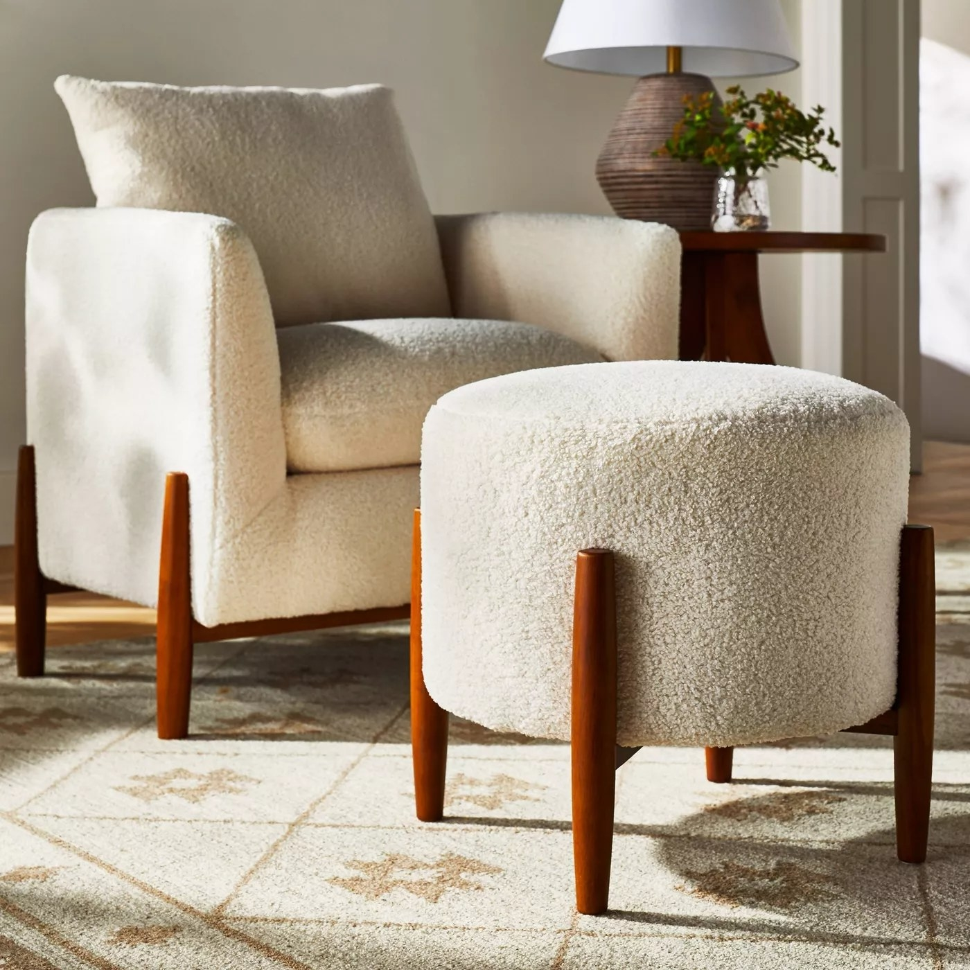 The ottoman placed in front of a matching accent chair