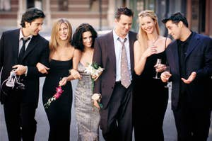 The Friends cast walk down a NYC street dressed in formal wear