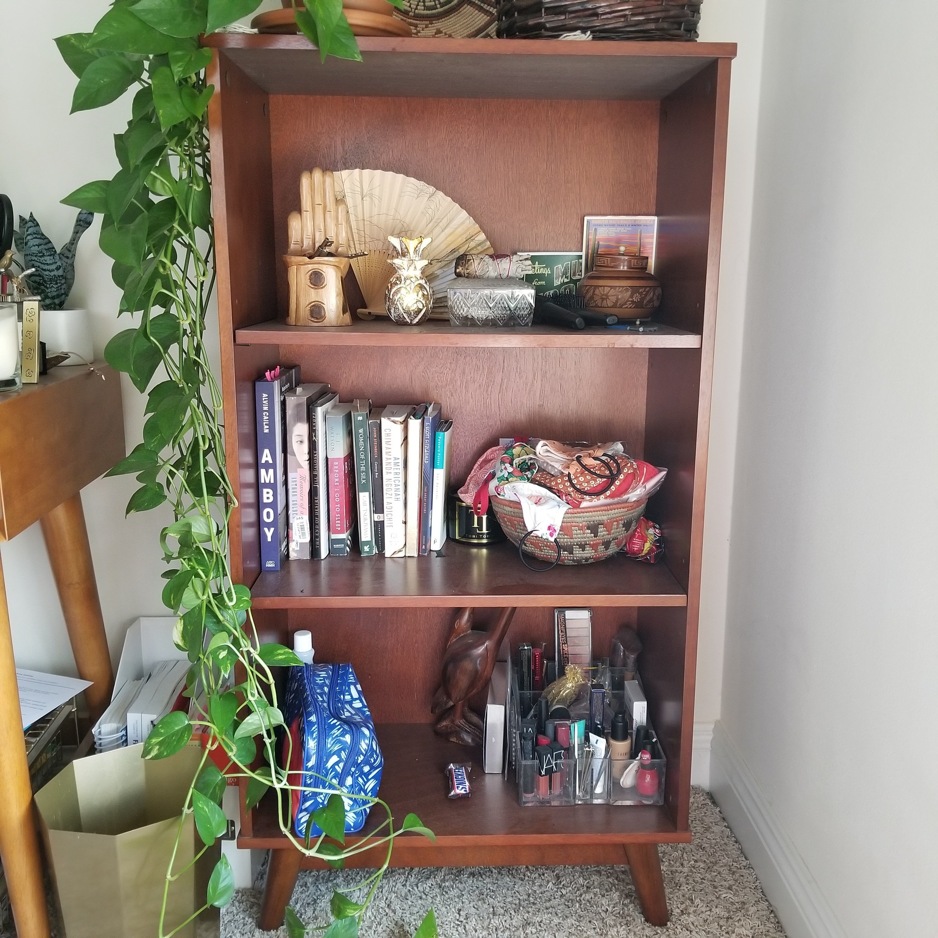 The shelf full of books and personal items