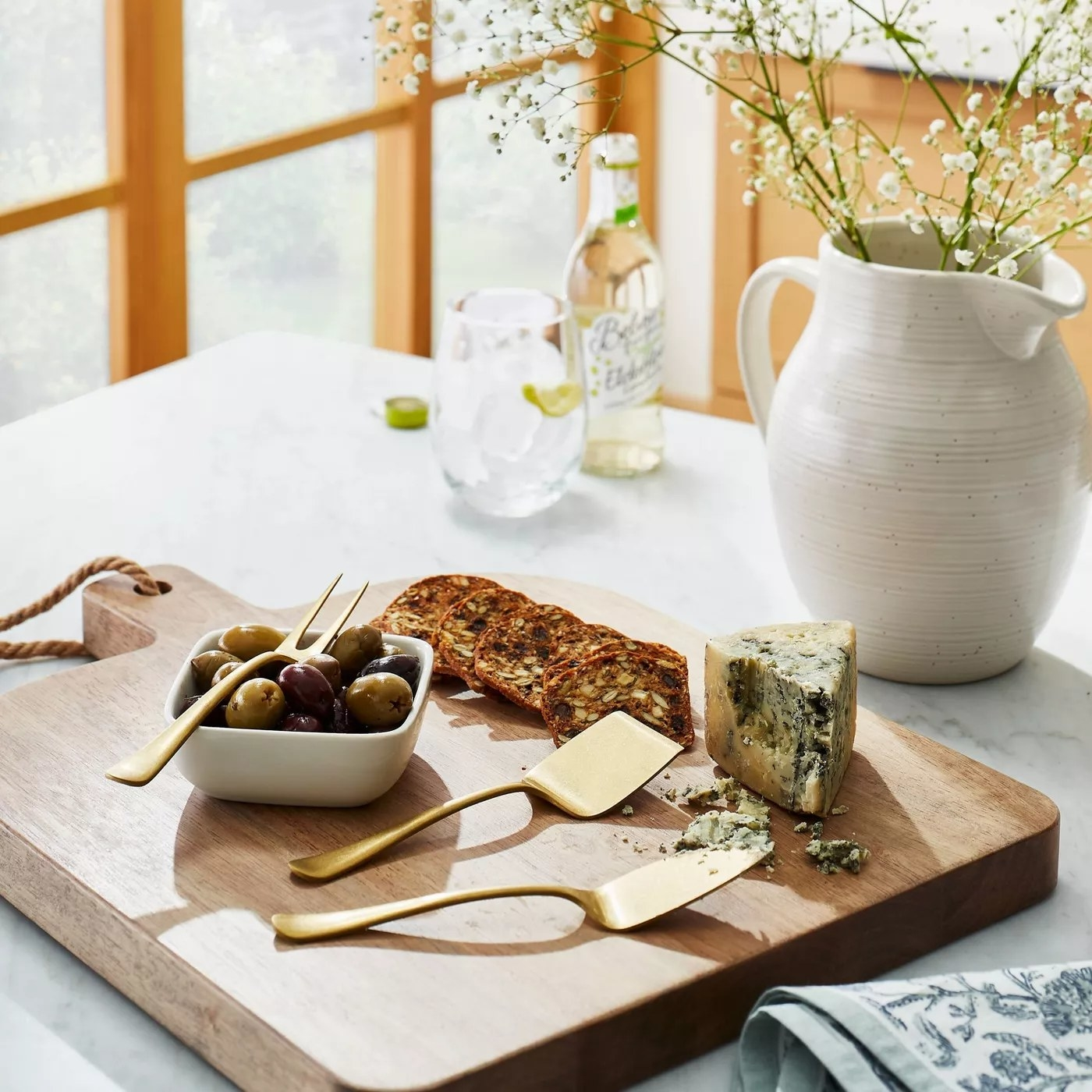 cheese knives and tray on counter