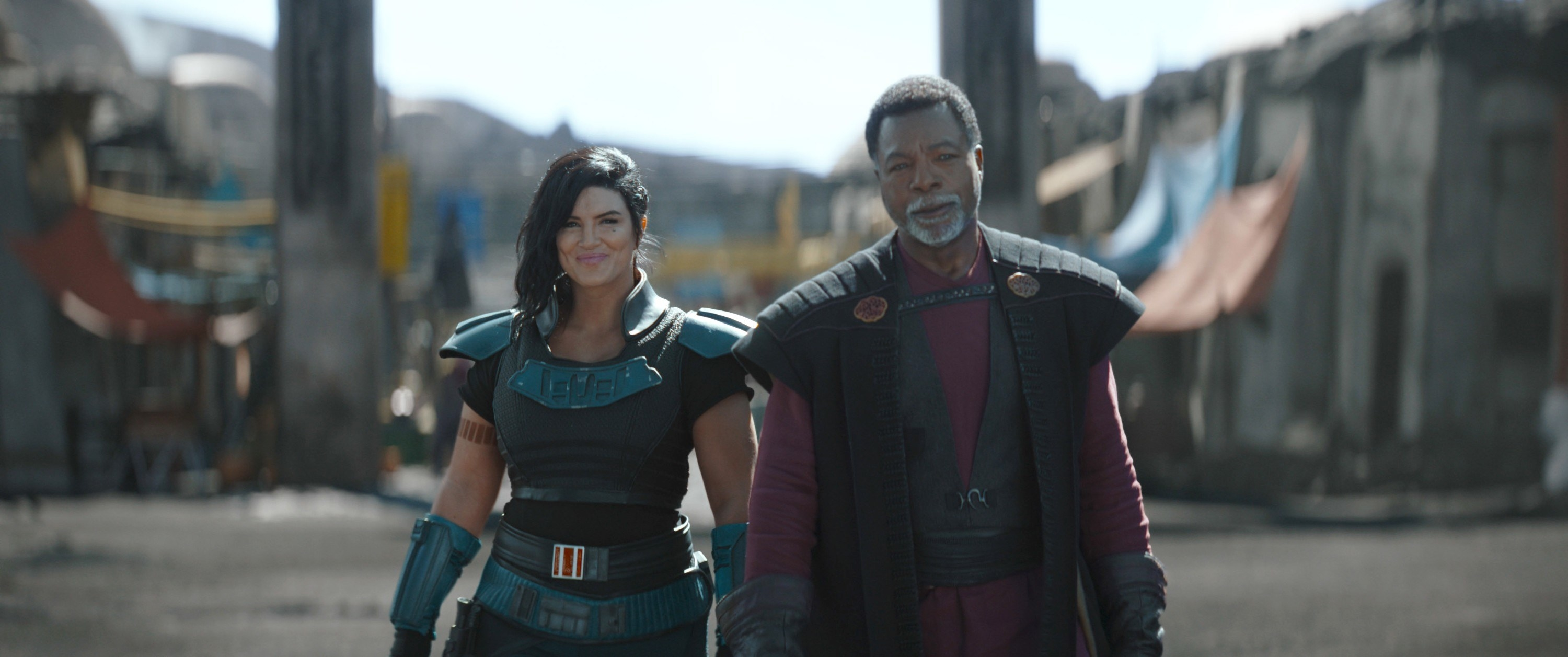 Gina Carano and Carl Weathers walk side by side in The Mandalorian
