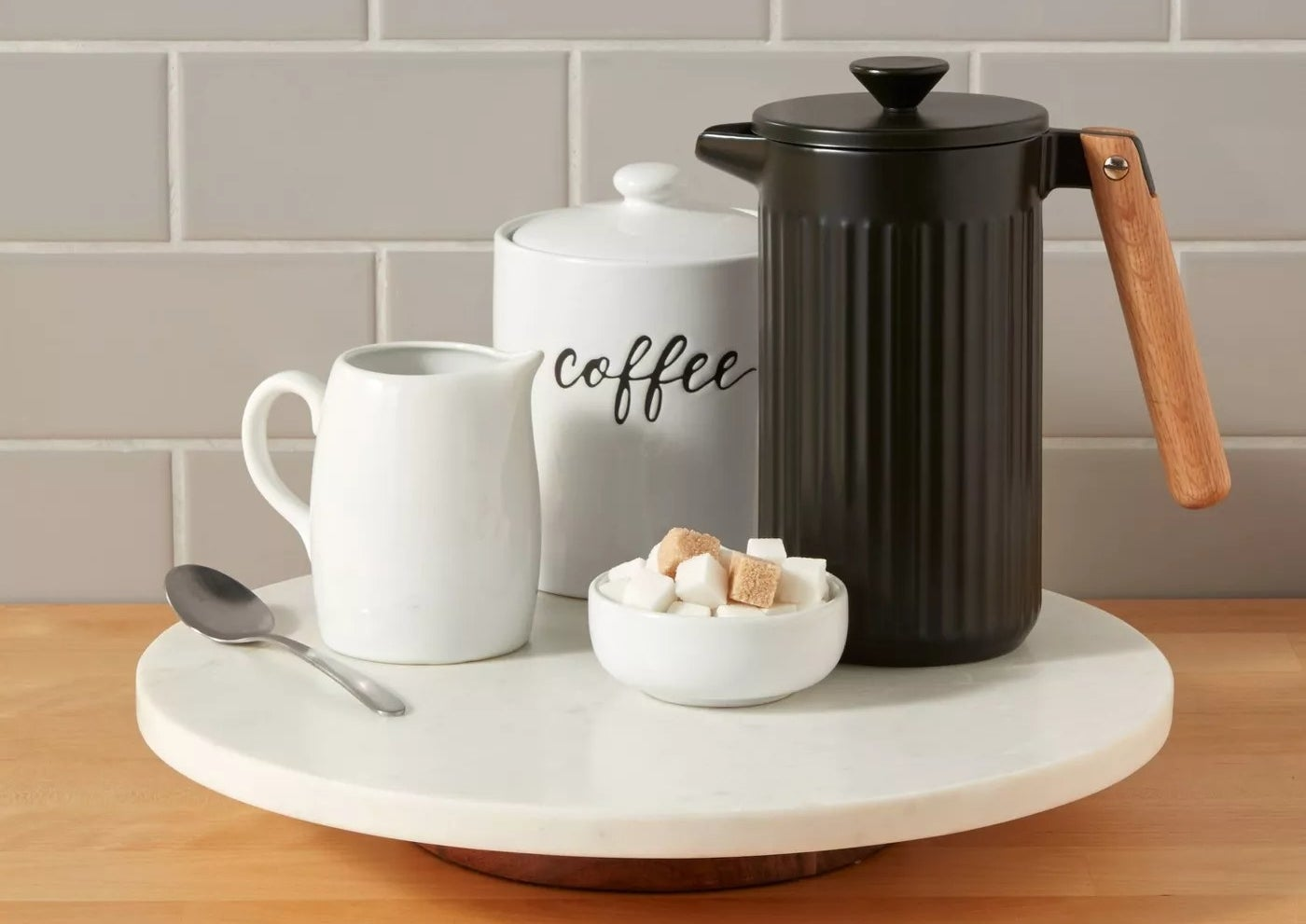 lazy susan with coffee mug and carafe on counter