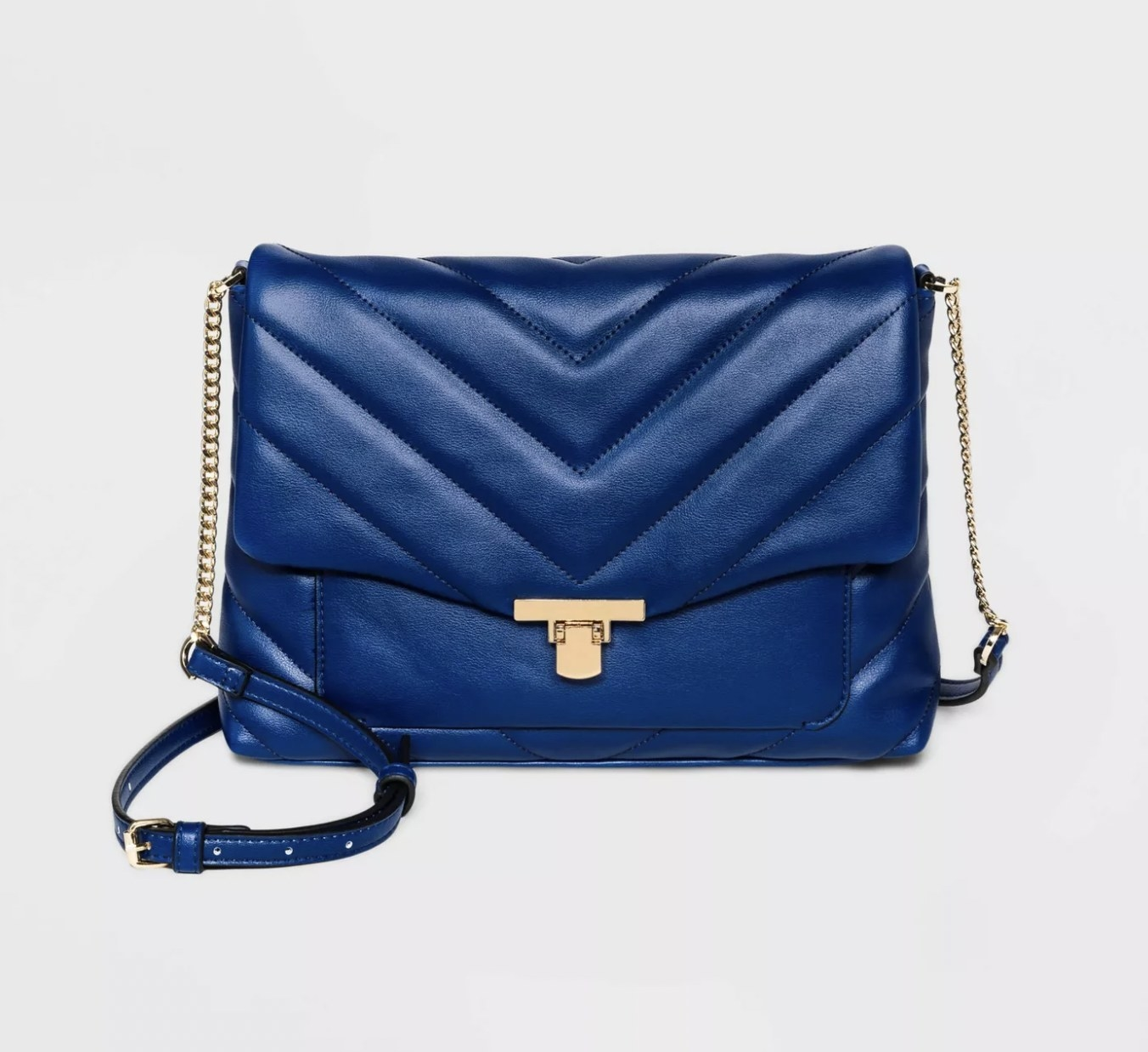 A blue, single compartment bag with a chain carry handle.