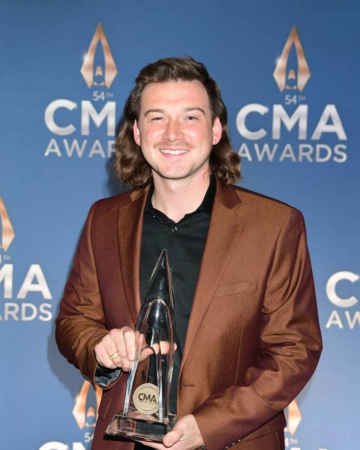 Morgan Wallen poses with an award at the CMA Awards