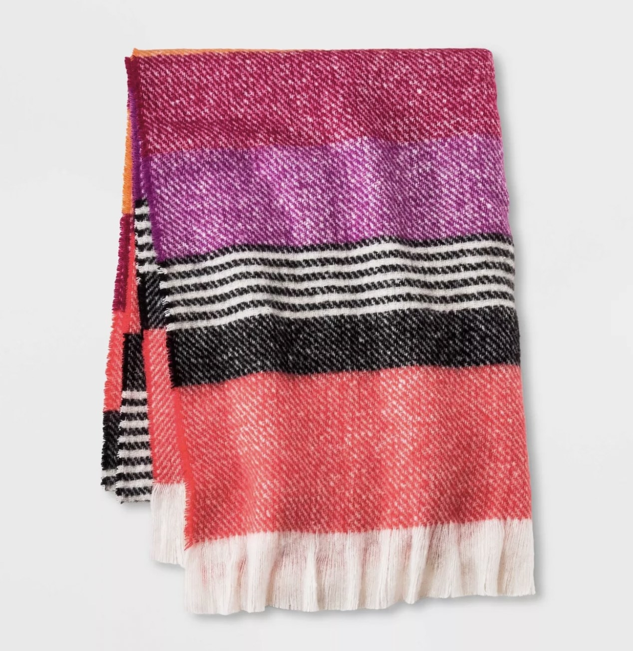 A mixed-patterned blanket scarf