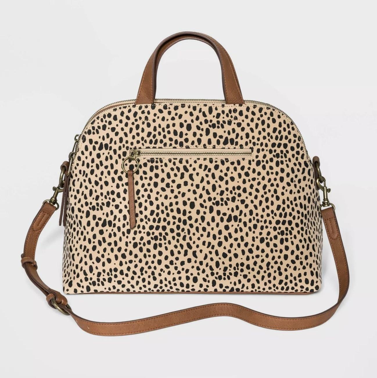 A shoulder bag with animal print