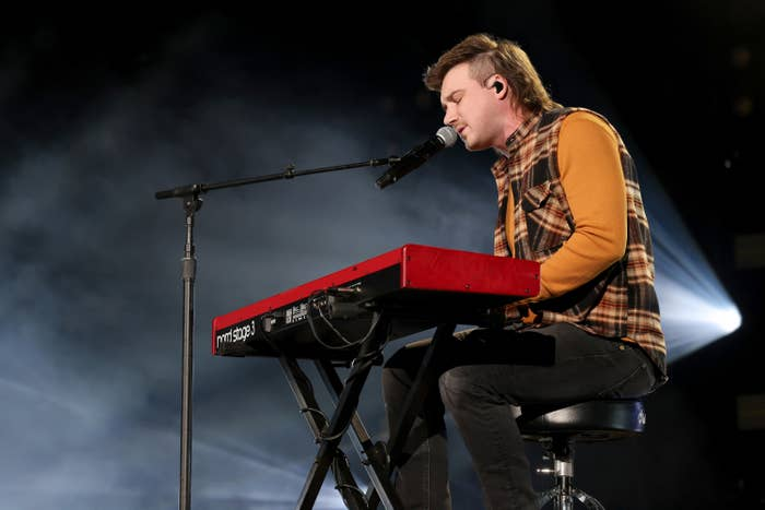 Morgan Wallen plays the keyboard and sings in Nashville's Ryman Auditorium in January 2021