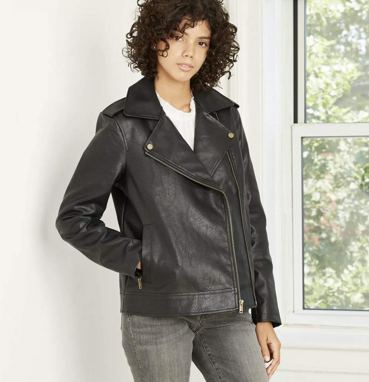 A model wearing a moto-styled leather jacket