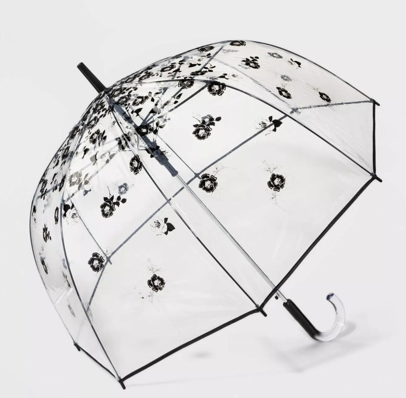 A bubble transparent umbrella with black floral detailing