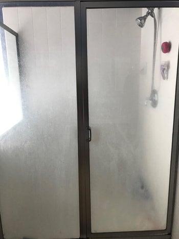 Reviewer photo of dirty glass shower door