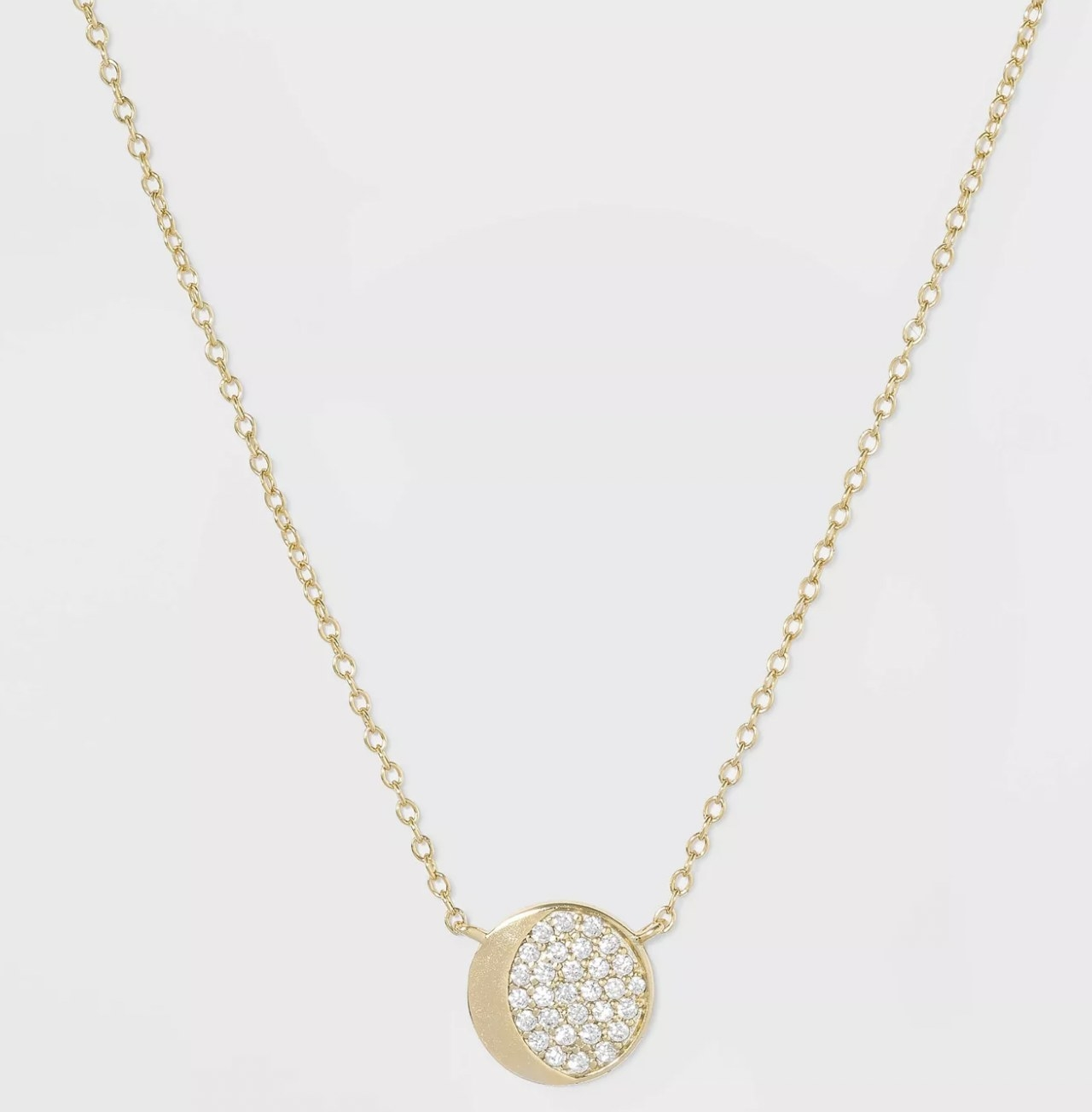 A half-moon necklace with cubic zirconia